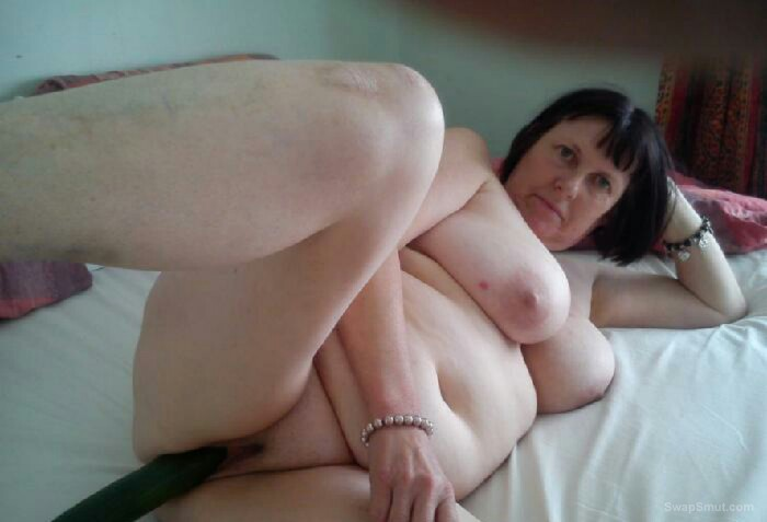 My Mrs fucking her fat pussy with a cucumber