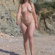Beach wife topless and nude on vacation
