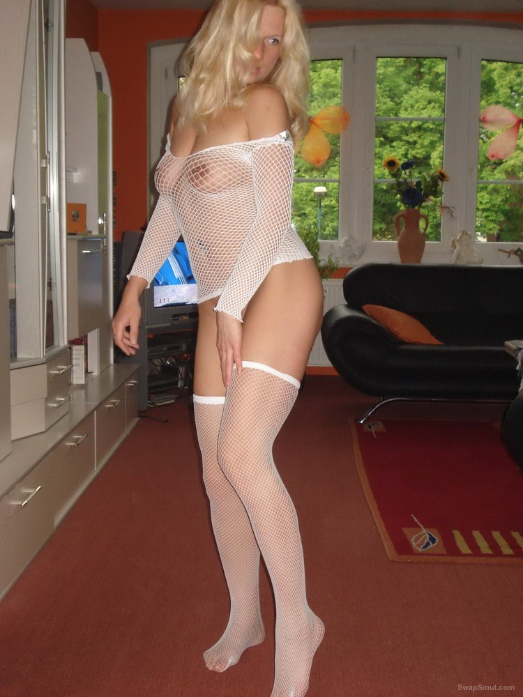 Blonde milf wearing fishnet stockings and top