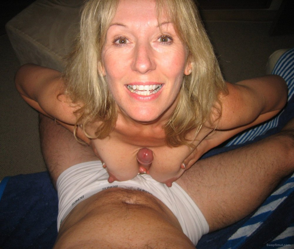 Stunning blonde milf having some adult fun using her cleavage on cock