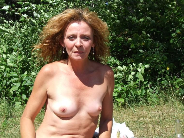 My sexy mature blonde wifes poses outside by the lake naked