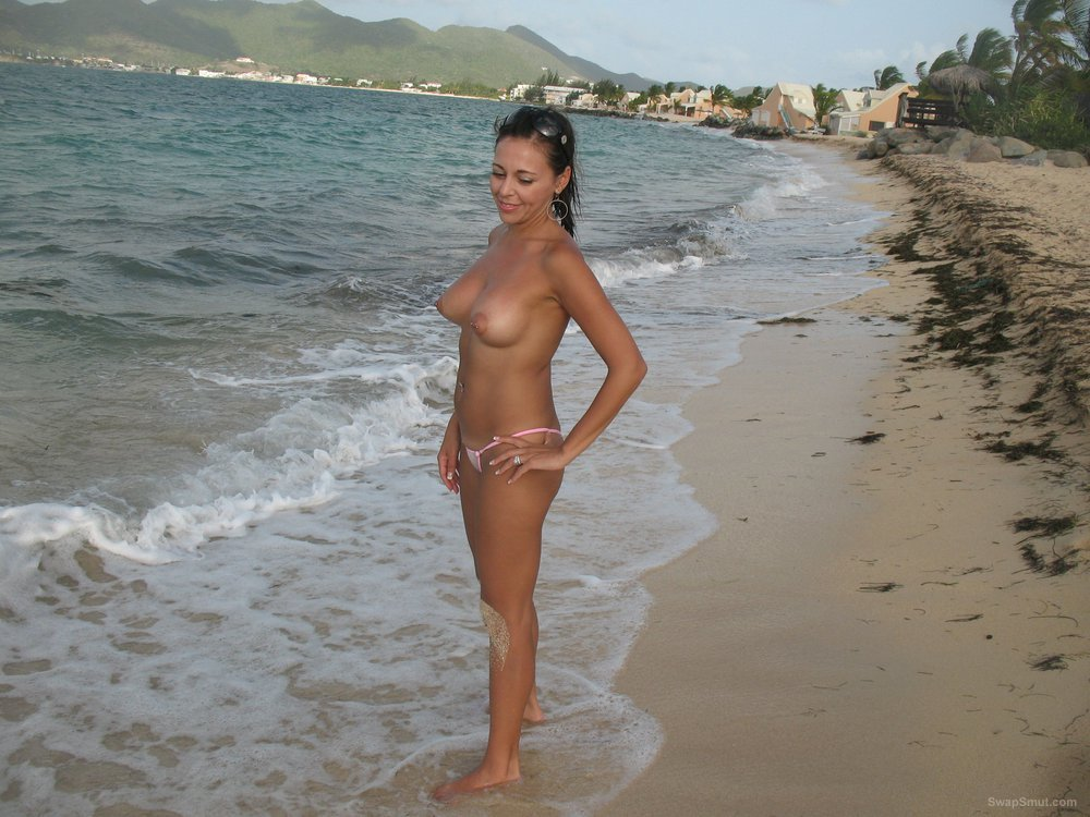 Big tit amateur milf in white G string standing in the surf