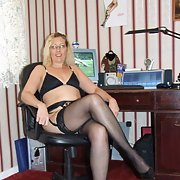 A UK milf named Tracy posing for a friend in stocking suspenders bra