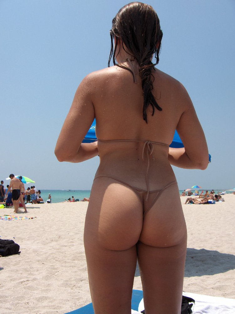 My Wife hanging out at the beach in her bikini walking around