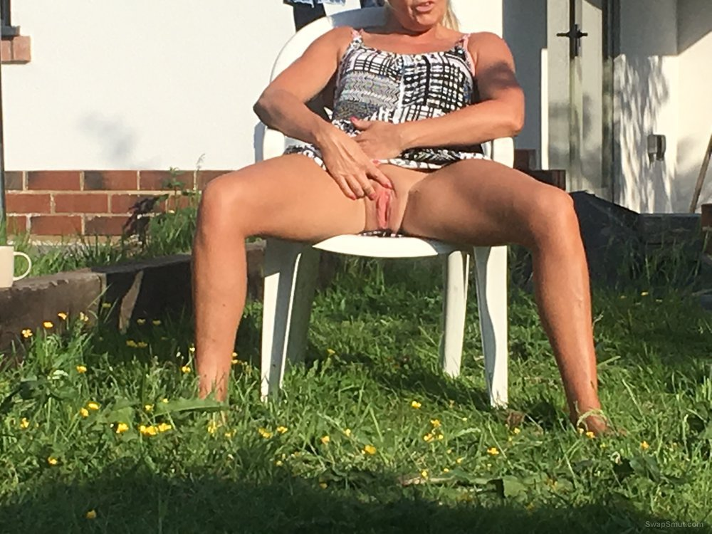 Milf playing with her pussy tits and flashing