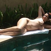 Slut enjoying her big tits out around the pool.
