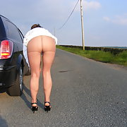 wife in tights showing bum in public side of a road