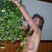 Watering the plants and doing chores nude