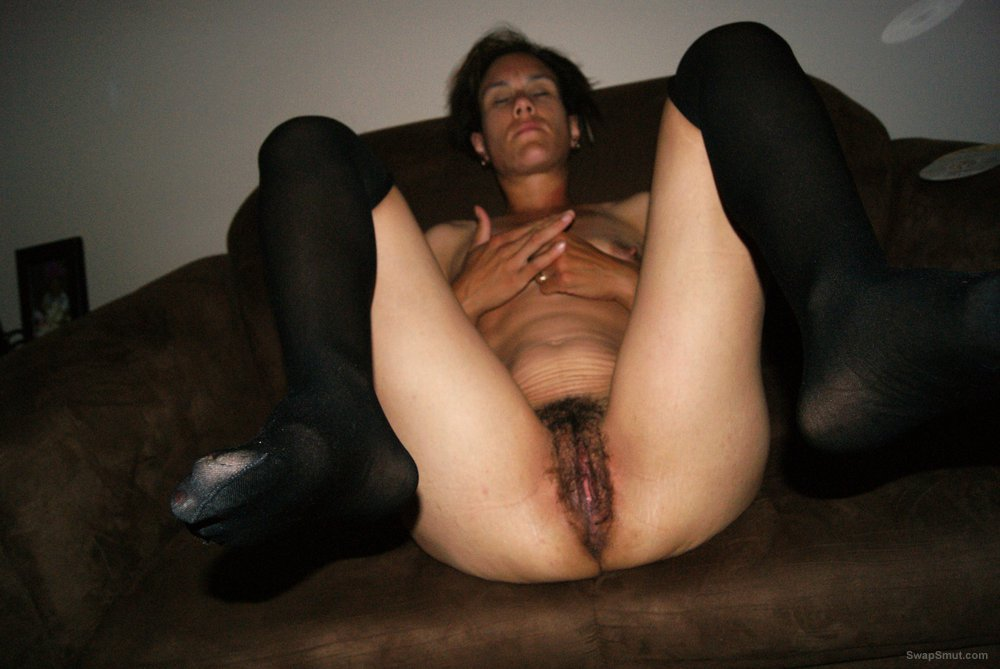 A set of me wearing only stockings exposing my hairy vagina
