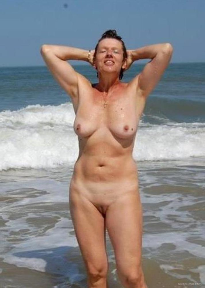 A hot milf showing off her bod at bthe beach