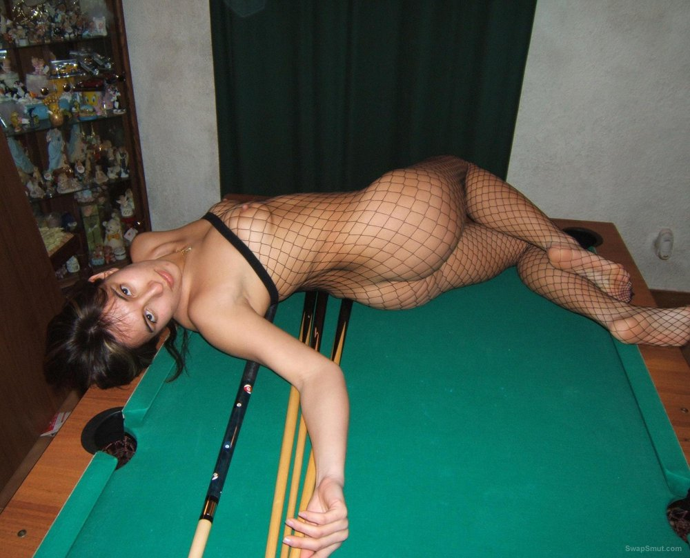 Slag Axlex sexy friend posing on a pool table playing with a pool cue