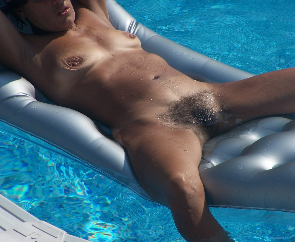 nude wife on a swimming pool inflatable lounger