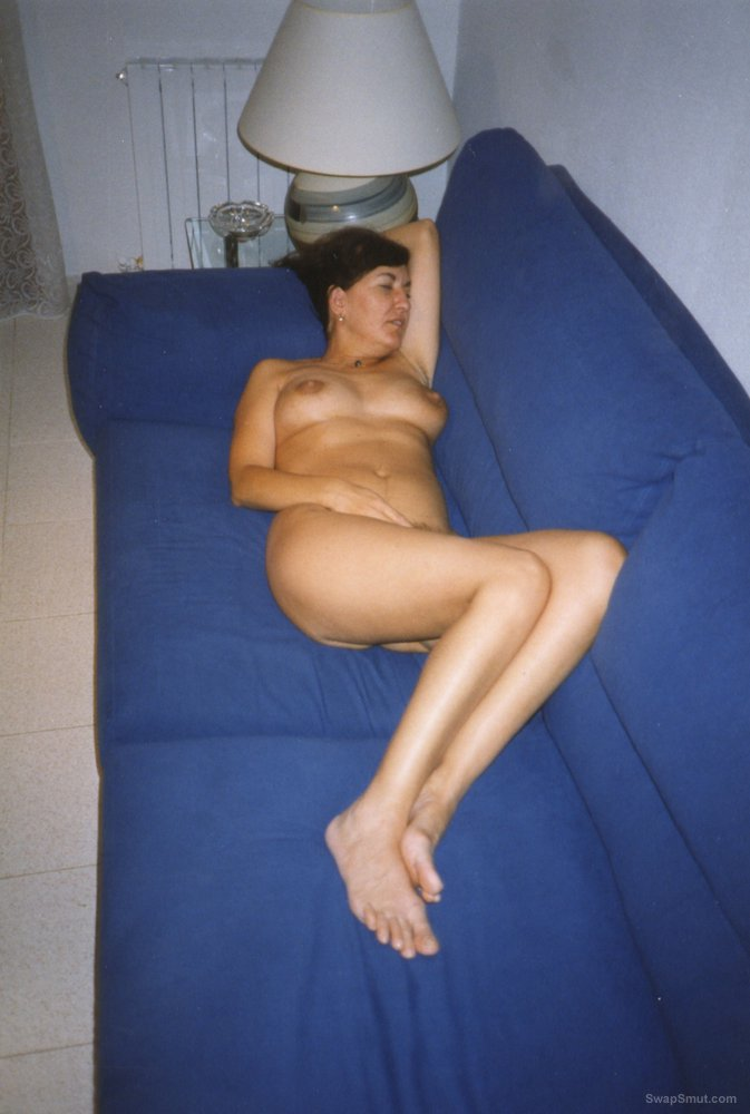My wife Salomé nude for your eyes relaxing on sofa and reading a book