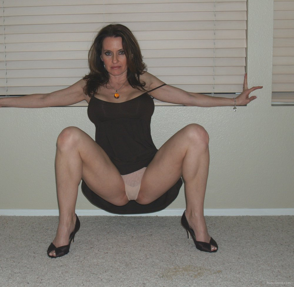 A very sexy bi milf posing at home lifting up her black dress to pleas