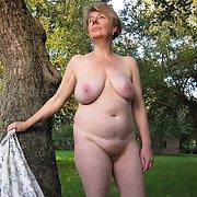 Ivana naked in her garden in the hot summer sun