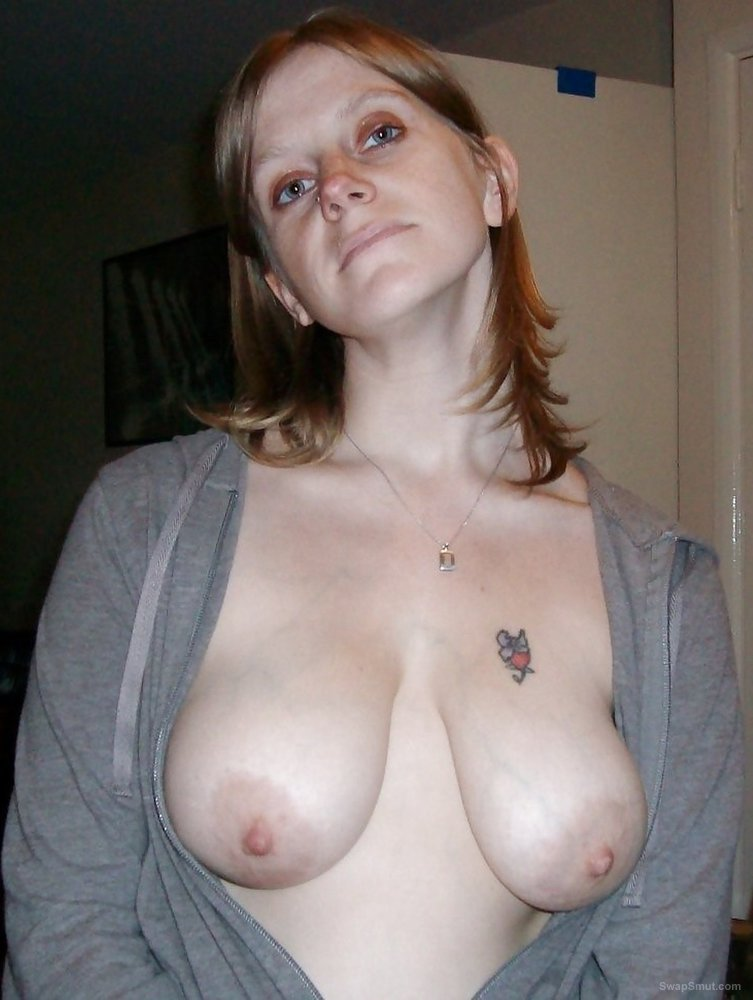 This young slut enjoys showing you her tits