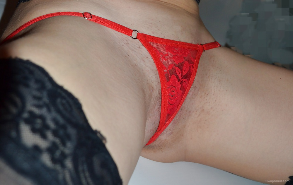 Wife wearing a tiny little red G string covering up her pussy