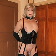 Rachel in black pvc basque, stockings and heels in chastity