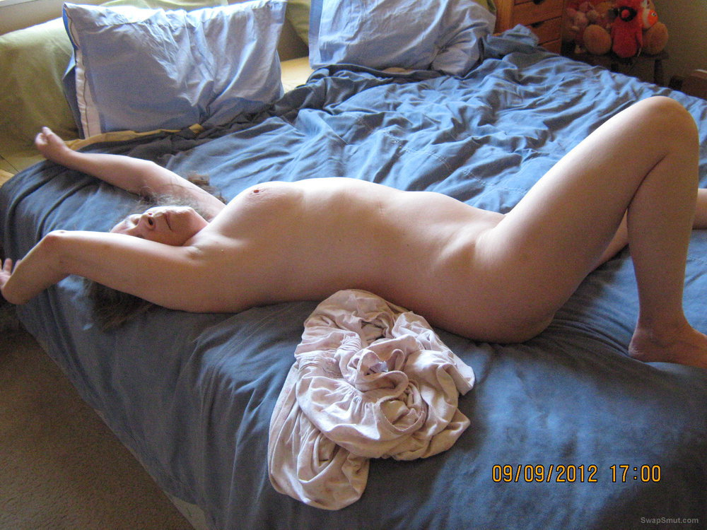 Sweet pussy getting ready for fun stretching out on the bed nude woman