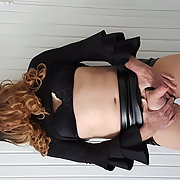 Crossdresser femdom in black open leather skirt and boots Part 2