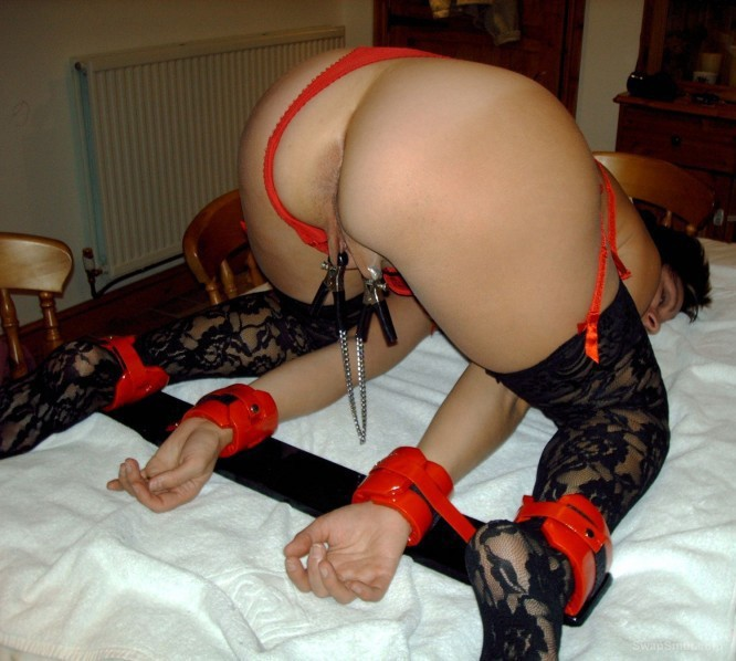 mature MARY legs and hands bound with pussy clamp