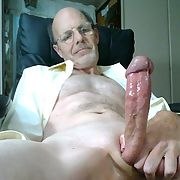 Stroking my hard and throbbing lubed up cock