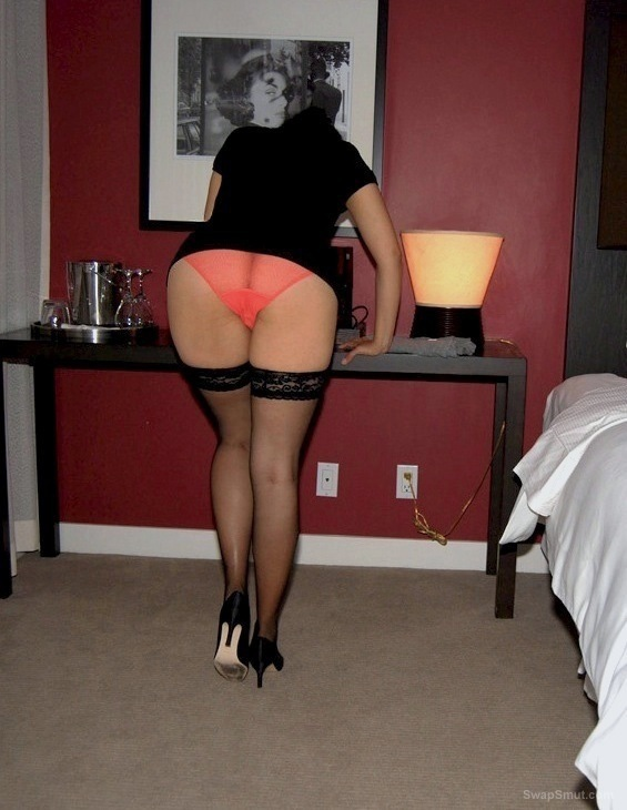 Amateur MILF with long legs in sexy stockings and heels