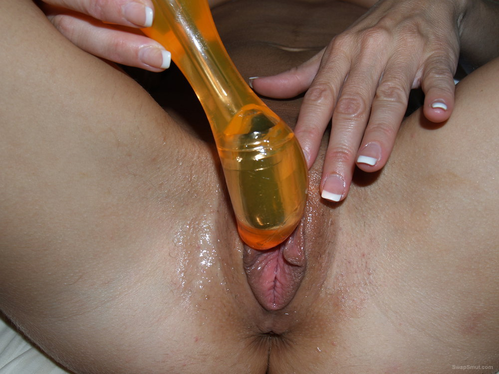She Just Loves her New Orange Sex Toy and Her Pussy Loves It Too