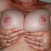 Tits out in the holiday apartment, hand bra for uplift