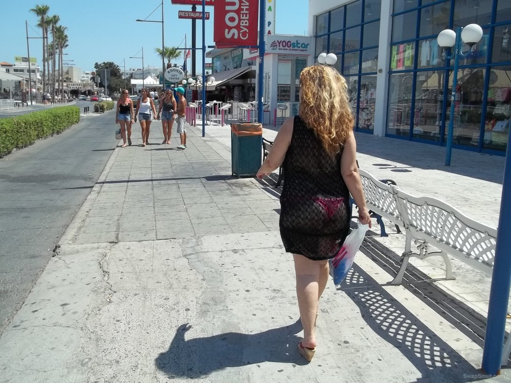 Horny sexy milf walking around in the sunshine
