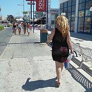 Horny sexy milf walking around in the sunshine