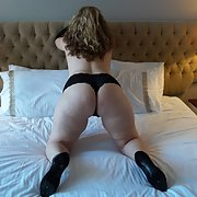 Sexy wife wearing heels and black knickers on the bed