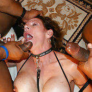 Amateur MILF wife with two BBC filling Her mouth with cum