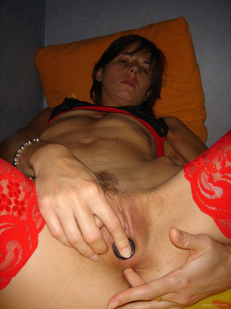 Dirty slut loves stuffing things up her ass