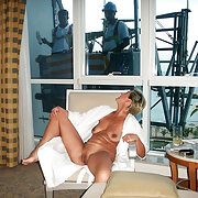Exposed Wife Alena observed through the window by cleaners