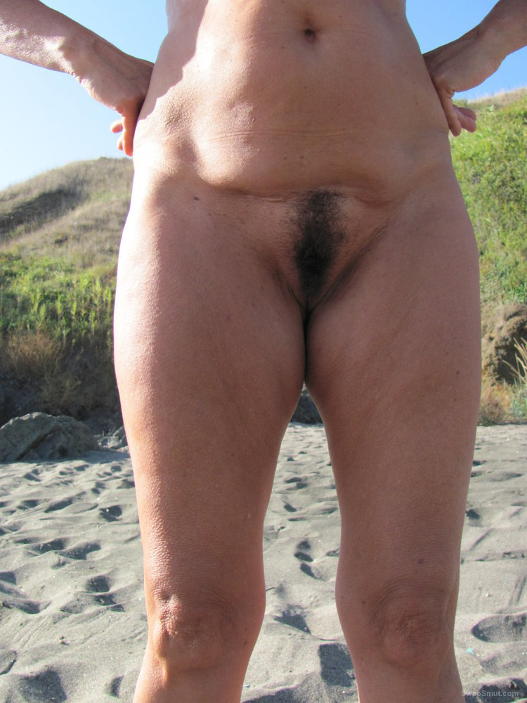 Close up of a hairy cunt of my mature gf at the public beach