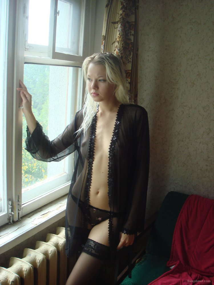 Alice Maska strips in front of her window for all to see