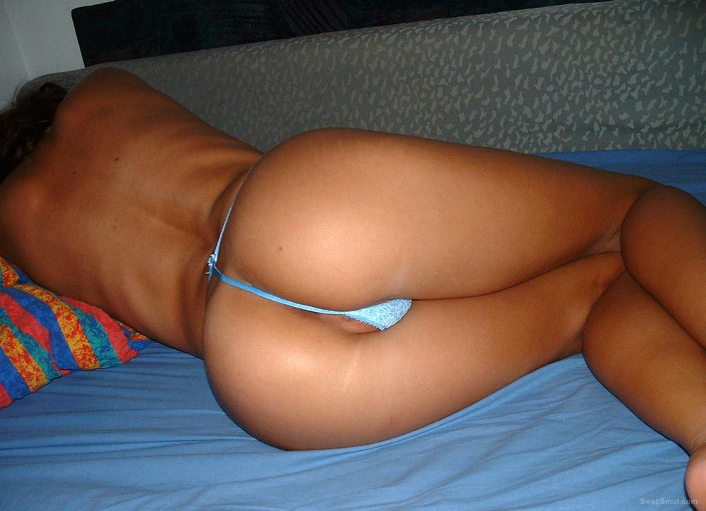 SLUT SANDRA wearing a thong showing off her tanned body