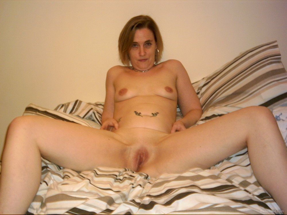 horny milf naked on the bed