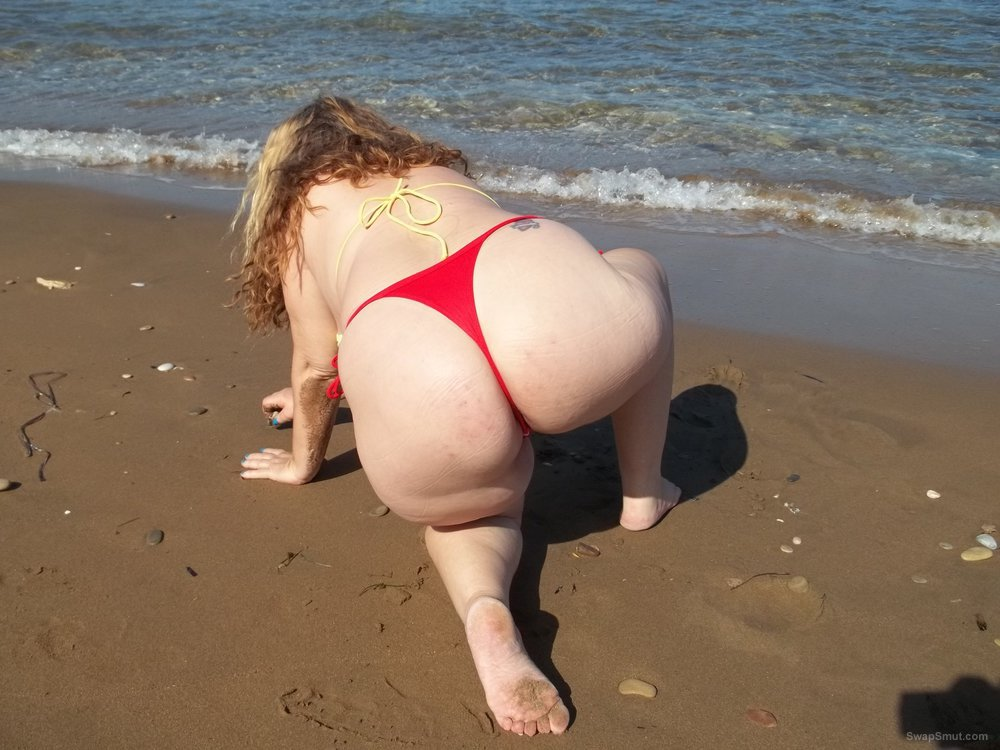 Feeling horny in a bikini on the beach by the sea