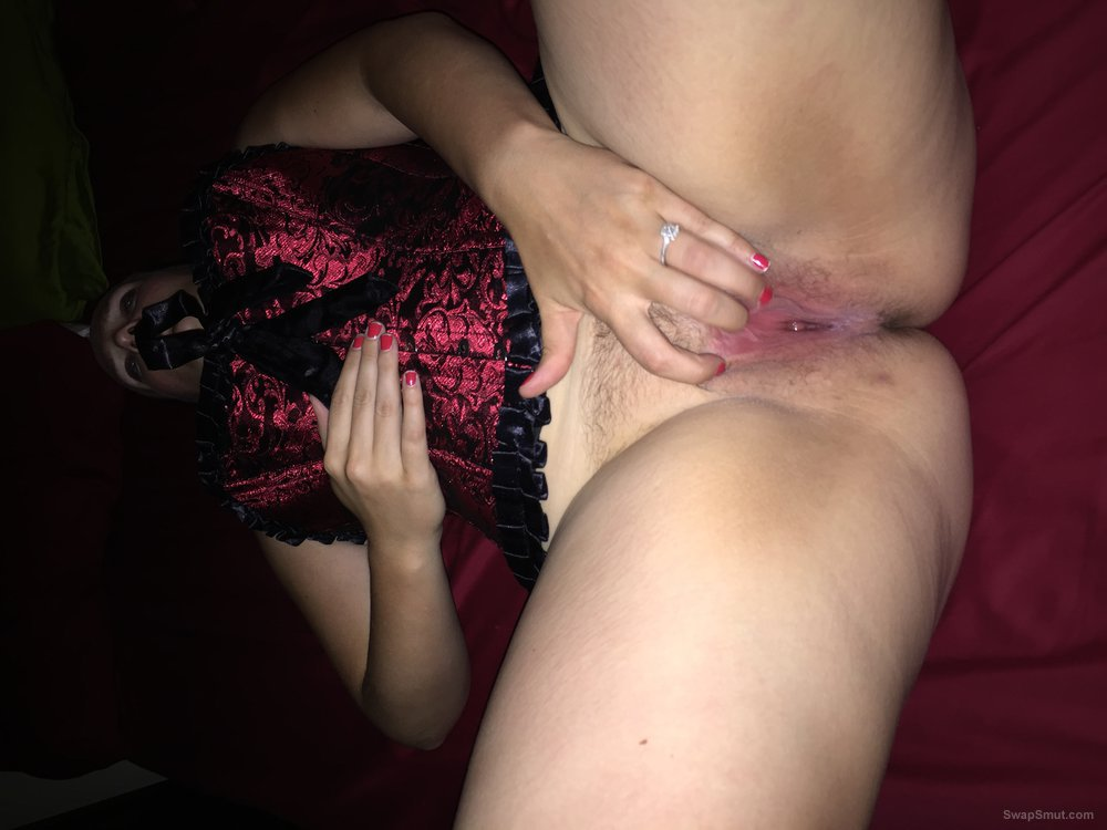 Wife in red corset fingering pussy