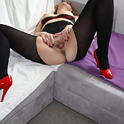 Sandra in red high heels and black stockings spreading vagina lips