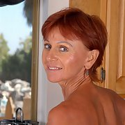 one sexy redhead GILF granny who i would like to fuck