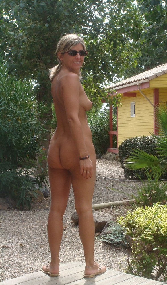 Tease and please with her sexy body naked body outdoors