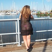Milf wife walking around in a see through dress outdoors in public