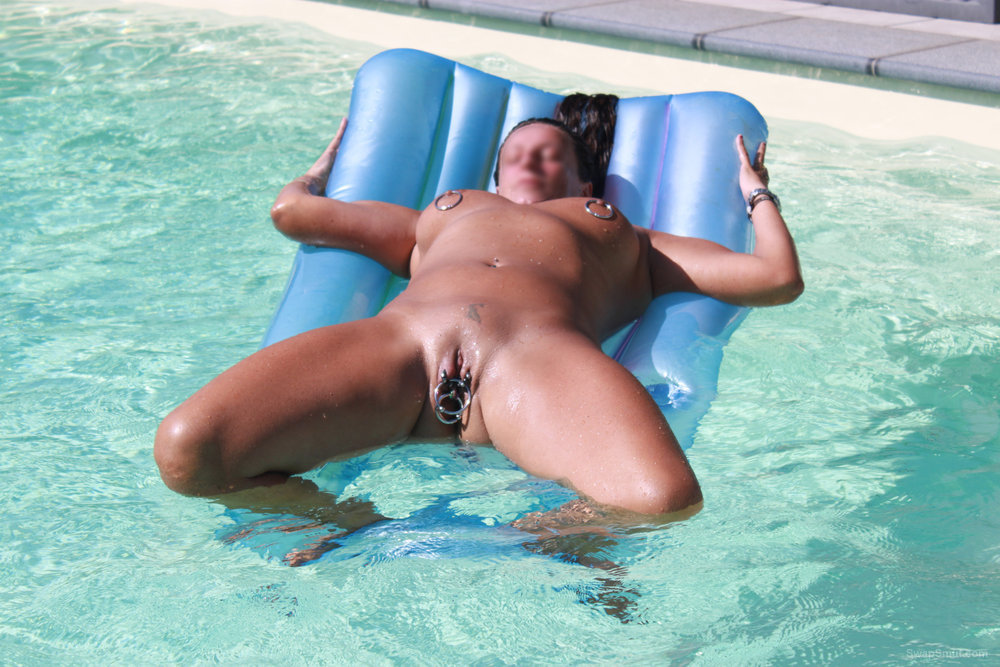 Nude near the pool with all my piercings jangling on pussy lips