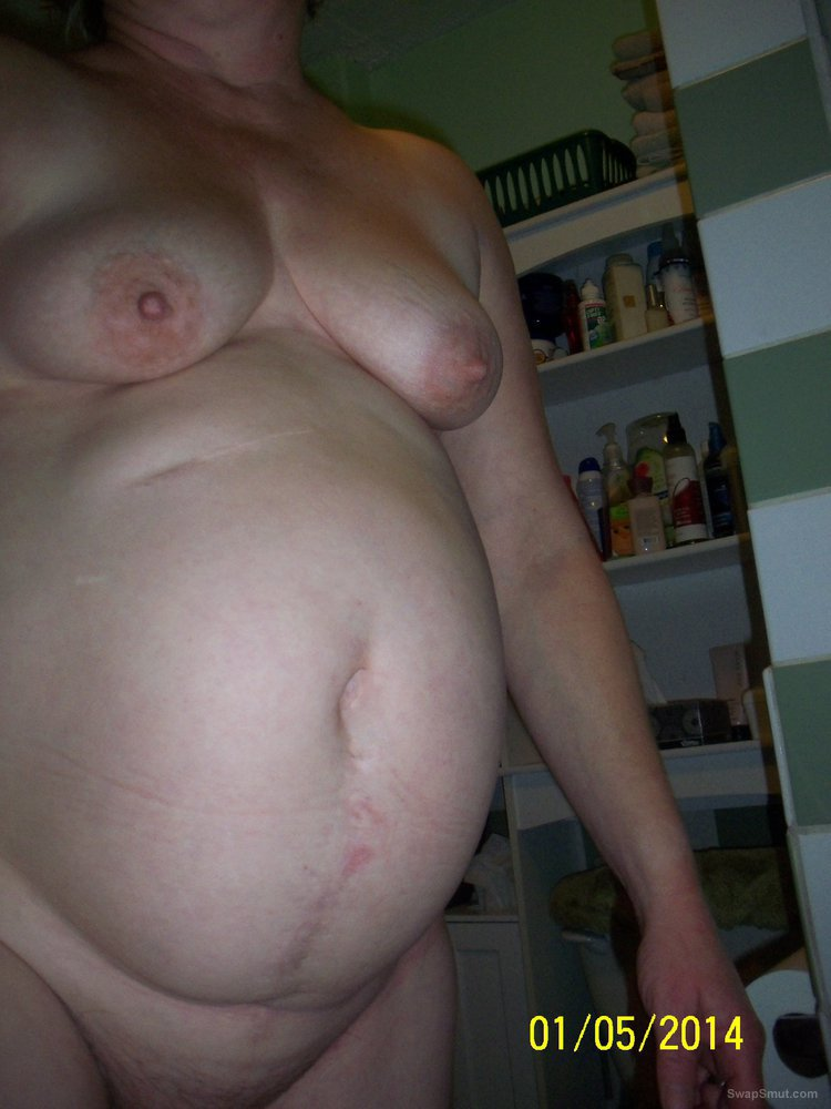 Big tittied BBW showing her tits in the bath naked