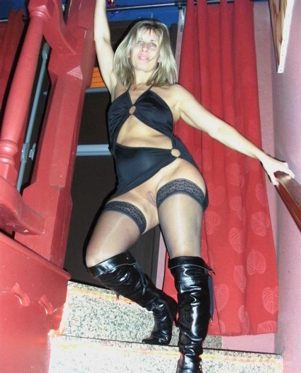Sexy milf LISA posing at a swingers club waiting to be used for sex