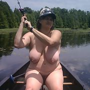 Slut wife fishing nude in public campground in canoe