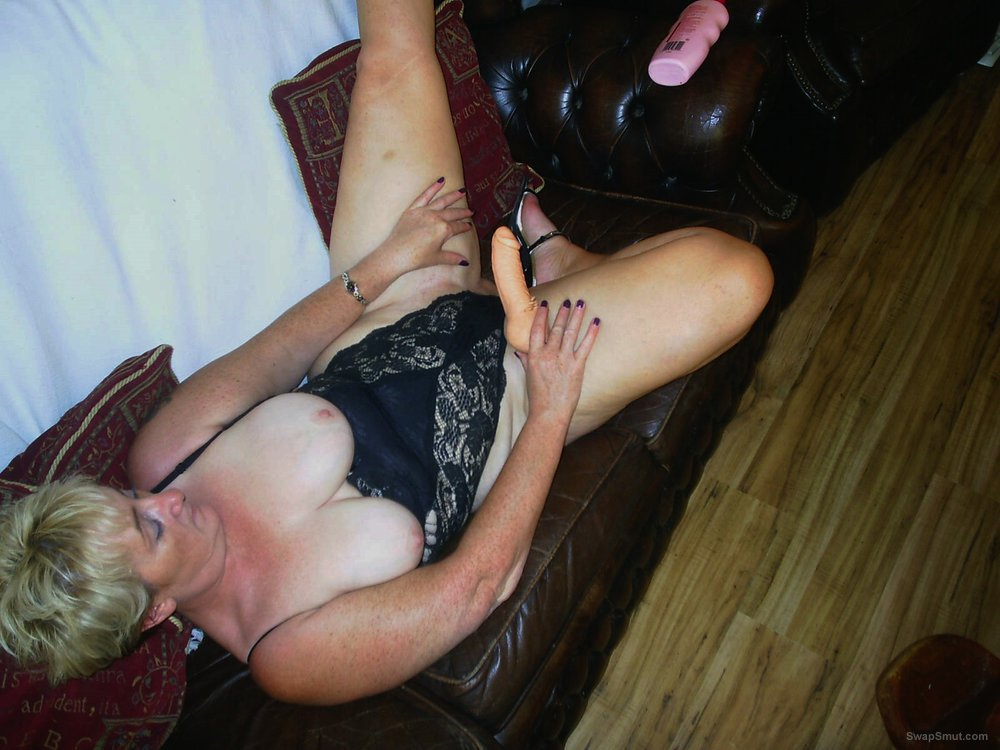 Mature wife putting on a toy show